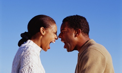 black woman and man yelling